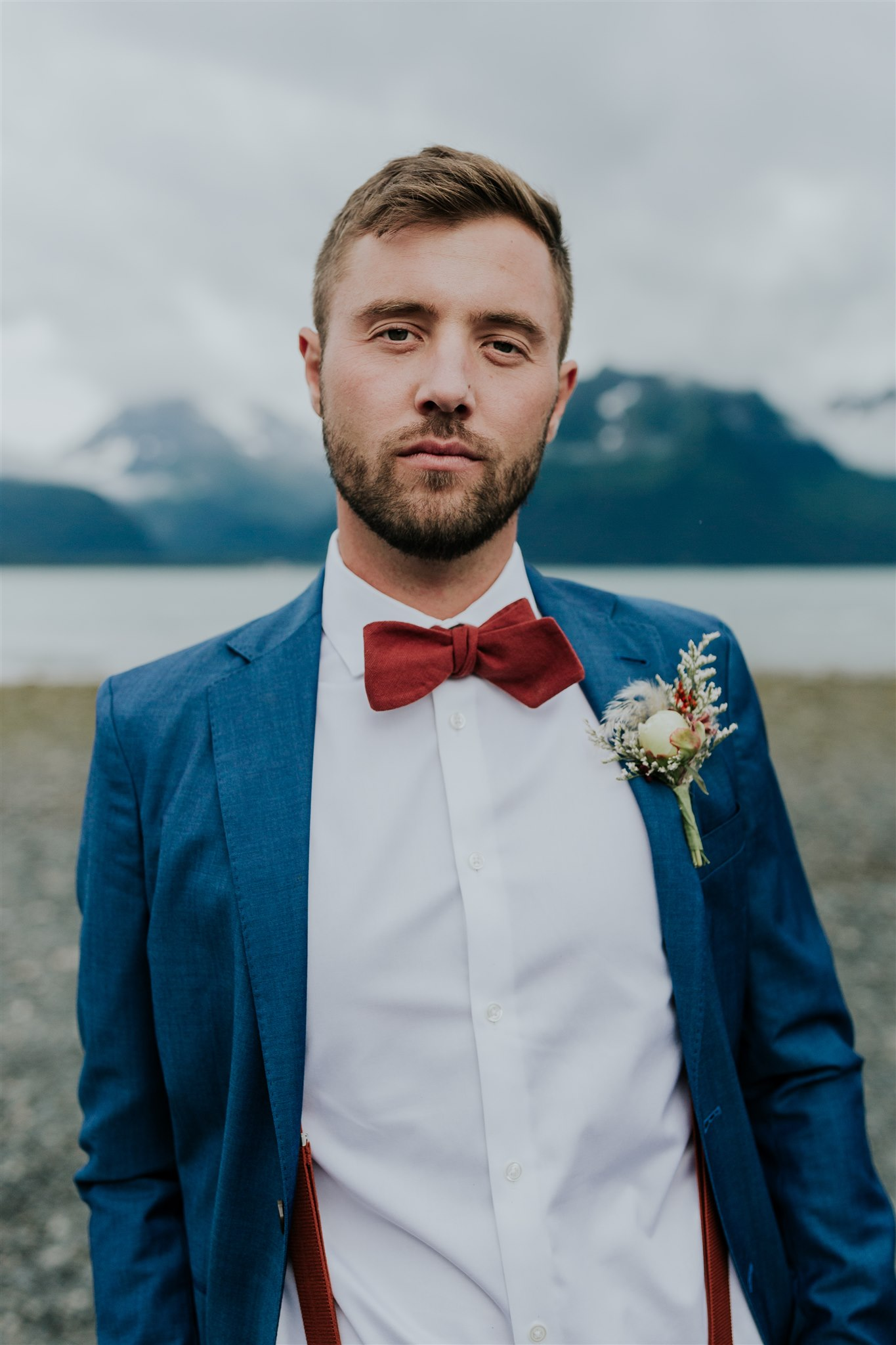 navy suit groom elopement rust bow tie alaska