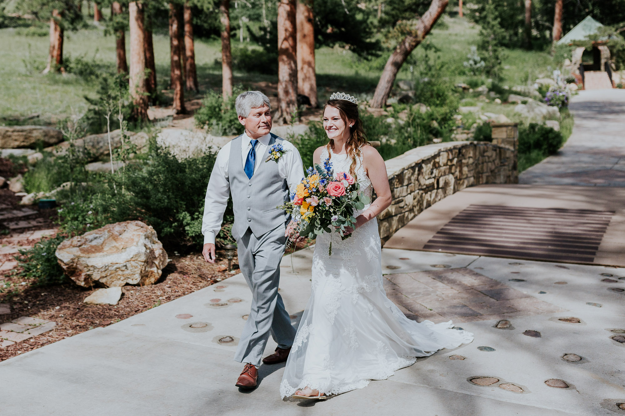 father walking bride down aisle wedding outdoor colorado