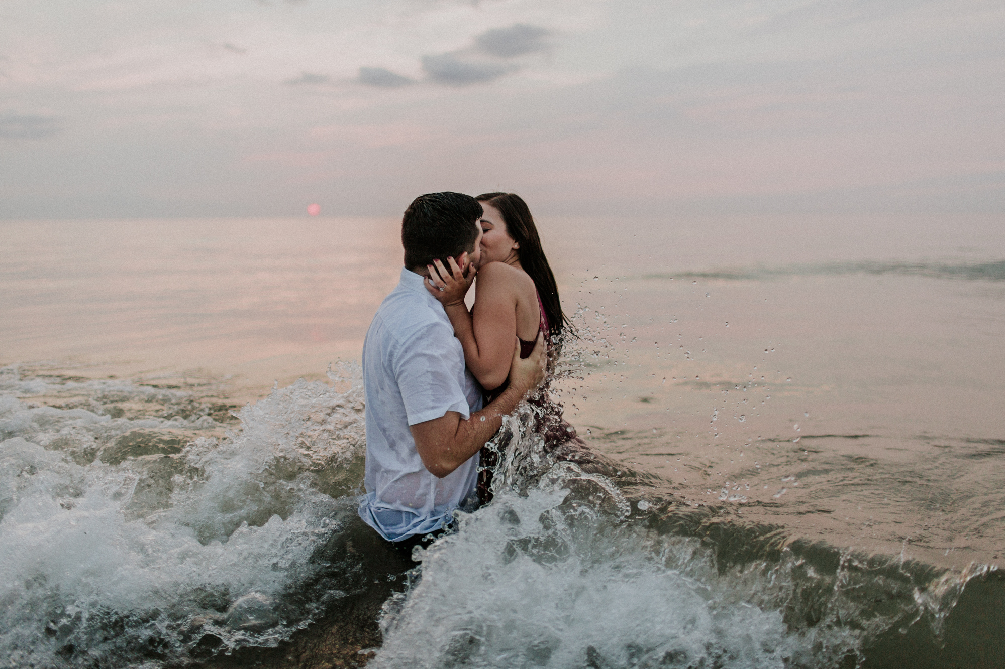 lake michigan engagement indiana elopement photographer wedding natural light playful beach couple water waves midwest