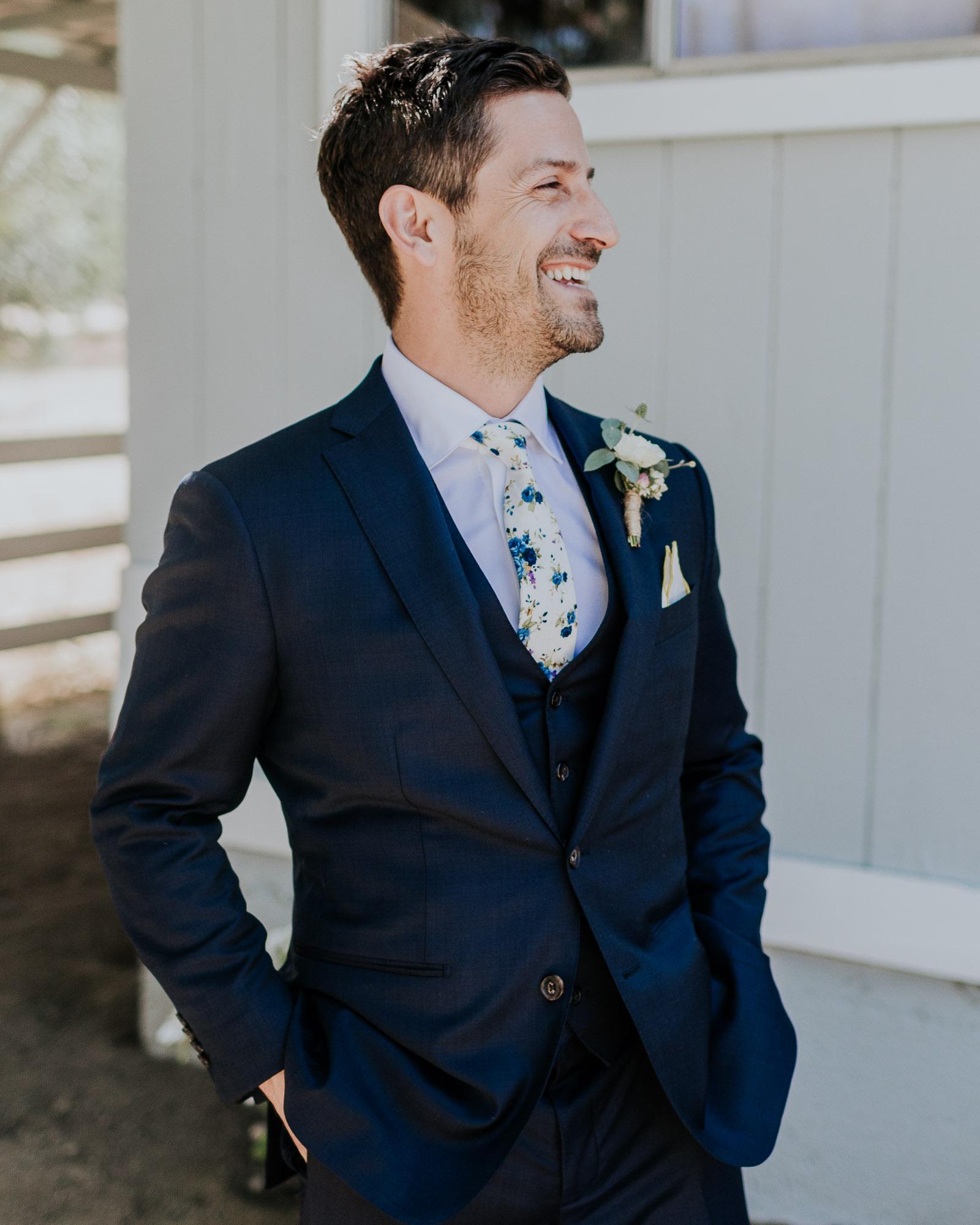 blue suit groom floral tie