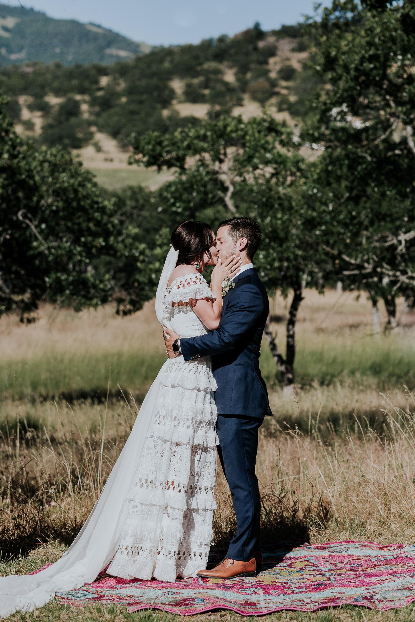 outdoor wedding first kiss